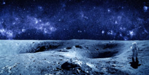 Image of astronaut on surface of moon with stars above the person.